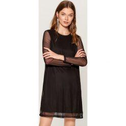 Sukienka z połyskującą aplikacją - Czarny. Czarne sukienki damskie Mohito, z aplikacjami. Za 99.99 zł.