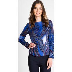 Niebieska bluzka w orientalny wzór QUIOSQUE. Niebieskie bluzki damskie QUIOSQUE, z jeansu, z długim rękawem. W wyprzedaży za 69.99 zł.