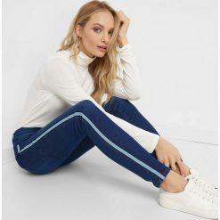Jeansy skinny z lampasami. Niebieskie jeansy damskie Orsay. Za 119.99 zł.