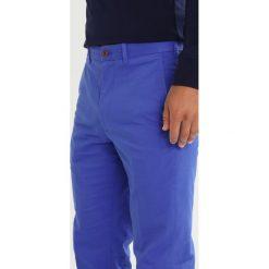Polo Ralph Lauren Golf TAILOREDFIT GOLF Spodnie materiałowe summer royal. Spodnie materiałowe męskie marki House. Za 549.00 zł.