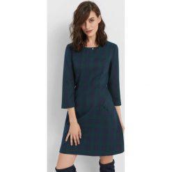 Trapezowa sukienka w kratę. Zielone sukienki damskie Orsay, na lato, z poliesteru, z dekoltem na plecach. Za 139.99 zł.