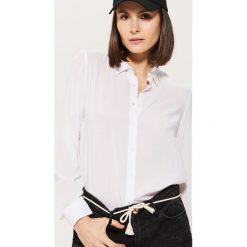 Gładka koszula - Biały. Koszule damskie marki SOLOGNAC. W wyprzedaży za 29.99 zł.