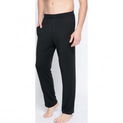 Calvin Klein Underwear - Spodnie piżamowe. Czarne piżamy męskie Calvin Klein Underwear, z dzianiny. W wyprzedaży za 129.90 zł.