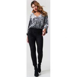 Trendyol Spodnie Yeni - Black. Czarne spodnie materiałowe damskie Trendyol, z materiału. Za 100.95 zł.