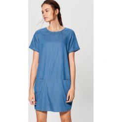 Jeansowa sukienka - Niebieski. Niebieskie sukienki damskie Mohito, z jeansu. Za 89.99 zł.