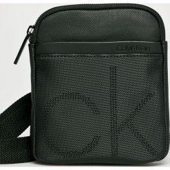 Calvin Klein - Saszetka. Czarne saszetki męskie Calvin Klein, z bawełny, casualowe. Za 269.90 zł.