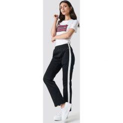 Calvin Klein Spodnie Side Stripe Track - Black. Czarne spodnie materiałowe damskie Calvin Klein. Za 526.95 zł.