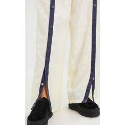 Fenty PUMA by Rihanna TEARAWAY TRACK Spodnie treningowe vanilla ice/evening blue. Spodnie dresowe damskie Fenty PUMA by Rihanna, z dresówki. Za 719.00 zł.