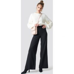 Trendyol Spodnie z luźnymi nogawkami - Black. Czarne spodnie materiałowe damskie Trendyol. Za 121.95 zł.