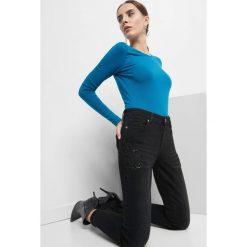 Jeansy skinny z koralikami. Czarne jeansy damskie Orsay. Za 129.99 zł.