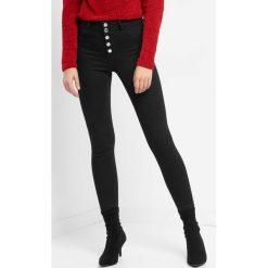 Jegginsy z wysokim stanem. Czarne legginsy damskie Orsay, z bawełny. Za 99.99 zł.