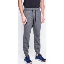 Under Armour - Spodnie Rival Cotton Jogger. Szare spodnie sportowe męskie Under Armour, z bawełny. W wyprzedaży za 219.90 zł.