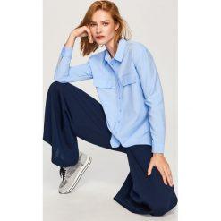 Błękitna koszula - Niebieski. Niebieskie koszule damskie Reserved. W wyprzedaży za 69.99 zł.