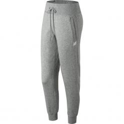 New Balance WP81552AG. Szare spodnie dresowe damskie New Balance, z dresówki. W wyprzedaży za 129.99 zł.