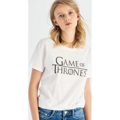 T-shirt Game of Thrones - Biały. T-shirty damskie marki DOMYOS. Za 39.99 zł.