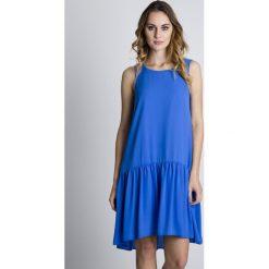 Niebieska oryginalna sukienka z falbaną u dołu BIALCON. Niebieskie sukienki damskie BIALCON, wizytowe, na ramiączkach. Za 133.00 zł.