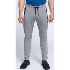 Spodnie treningowe męskie SPMTR200 - średni szary melanż. Spodnie sportowe męskie marki bonprix. W wyprzedaży za 99.99 zł.
