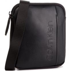 Saszetka CALVIN KLEIN - Elevated Logo Mini Flat Crossover K50K503874 001. Czarne saszetki męskie Calvin Klein, ze skóry ekologicznej, młodzieżowe. Za 299.00 zł.
