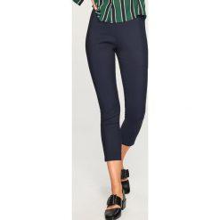 Eleganckie spodnie - Granatowy. Niebieskie spodnie materiałowe damskie Reserved. W wyprzedaży za 49.99 zł.