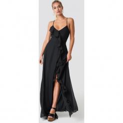 Trendyol Sukienka maxi z falbaną Abiye - Black. Czarne sukienki damskie Trendyol, z dekoltem na plecach. Za 262.95 zł.