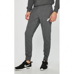 Nike Sportswear - Spodnie. Szare spodnie sportowe męskie Nike Sportswear, z bawełny. W wyprzedaży za 179.90 zł.