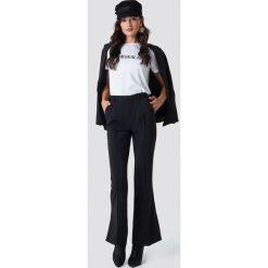 NA-KD Classic Spodnie garniturowe Seamline - Black. Czarne spodnie materiałowe damskie NA-KD Classic, z poliesteru. Za 202.95 zł.