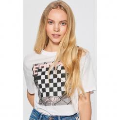Koszulka z motywem szachownicy - Biały. T-shirty damskie marki DOMYOS. W wyprzedaży za 29.99 zł.
