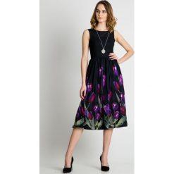 Sukienka midi z kwiatami u dołu BIALCON. Czarne sukienki damskie BIALCON, na lato, z materiału, eleganckie. Za 449.00 zł.