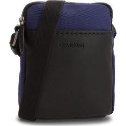 Saszetka CALVIN KLEIN - Multi Task Mini Repo K50K503782 447. Niebieskie saszetki męskie Calvin Klein, z materiału, młodzieżowe. Za 299.00 zł.