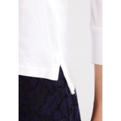 Polo Ralph Lauren SLIM FIT Koszulka polo white. Koszulki polo męskie Polo Ralph Lauren, z bawełny, polo. Za 479.00 zł.