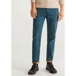 Jeansy slim fit dzianinowe - Turkusowy. Niebieskie jeansy męskie Reserved. Za 149.99 zł.