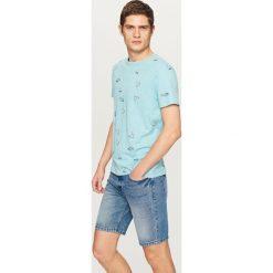 T-shirt z nadrukiem - Turkusowy. T-shirty dla chłopców Reserved, z nadrukiem. W wyprzedaży za 14.99 zł.