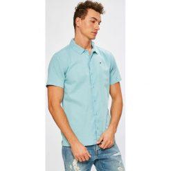 Tommy Jeans - Koszula. Szare koszule męskie Tommy Jeans, z bawełny, z klasycznym kołnierzykiem, z krótkim rękawem. W wyprzedaży za 219.90 zł.