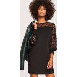 Sukienka z koronką - Czarny. Czarne sukienki damskie Reserved, w koronkowe wzory, z koronki. Za 119.99 zł.