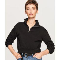 Krótka bluza ze stójką - Czarny. Bluzy damskie marki KALENJI. W wyprzedaży za 34.99 zł.
