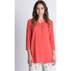 Luźna bluzka z suwakiem przy dekolcie BIALCON. Pomarańczowe bluzki damskie BIALCON, w jednolite wzory, z materiału, wizytowe, z długim rękawem. W wyprzedaży za 84.00 zł.