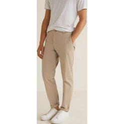 Mango Man - Spodnie Barna3. Eleganckie spodnie męskie marki Giacomo Conti. W wyprzedaży za 99.90 zł.