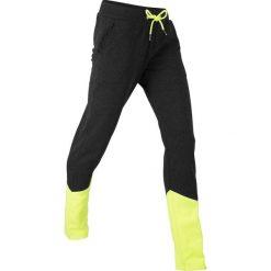 Spodnie dresowe, długie, z kolekcji Maite Kelly bonprix czarno-żółty neonowy melanż. Czarne spodnie dresowe damskie bonprix, melanż, z dresówki. Za 74.99 zł.