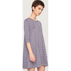 Sukienka z rozkloszowanym dołem - Fioletowy. Fioletowe sukienki damskie Reserved. Za 79.99 zł.