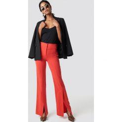Trendyol Spodnie z rozcięciami z przodu - Red. Czerwone spodnie materiałowe damskie Trendyol, z haftami, z lyocellu. Za 121.95 zł.