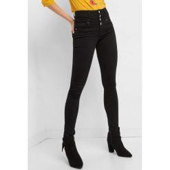 Jeansy skinny z wysokim stanem. Czarne jeansy damskie Orsay. Za 139.99 zł.