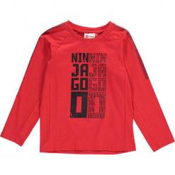 """Koszulka """"Thomas 702"""" w kolorze czerwonym. Czerwone t-shirty dla chłopców marki Lego Wear Fashion, z nadrukiem, z długim rękawem. W wyprzedaży za 49.95 zł."""