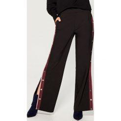 Spodnie z rozpinanymi nogawkami - Czarny. Czarne spodnie materiałowe damskie Mohito. Za 149.99 zł.