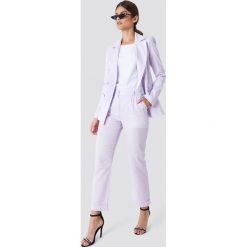 Trendyol Lniane spodnie - Purple. Fioletowe spodnie materiałowe damskie Trendyol. W wyprzedaży za 80.98 zł.