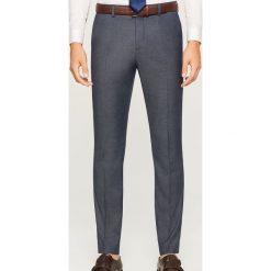 Spodnie garniturowe z tkaniny strukturalnej - Niebieski. Eleganckie spodnie męskie marki Giacomo Conti. W wyprzedaży za 89.99 zł.
