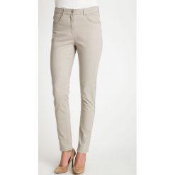 Beżowe spodnie w kropki QUIOSQUE. Brązowe spodnie materiałowe damskie QUIOSQUE, w kropki, z bawełny. W wyprzedaży za 89.99 zł.