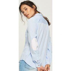 Koszula z łatami na łokciach - Niebieski. Koszule damskie marki SOLOGNAC. W wyprzedaży za 39.99 zł.