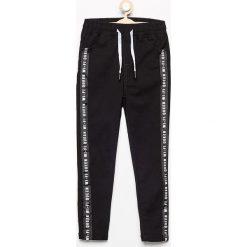 Spodnie z lampasami - Czarny. Czarne spodnie materiałowe damskie Reserved. Za 79.99 zł.