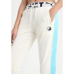 Fenty PUMA by Rihanna FITTED TRACK PANT Spodnie treningowe vanilla ice. Spodnie dresowe damskie Fenty PUMA by Rihanna, z bawełny. Za 719.00 zł.