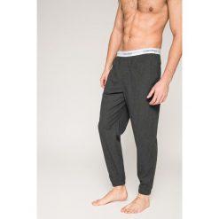Calvin Klein Underwear - Spodnie piżamowe. Szare piżamy męskie Calvin Klein Underwear, z bawełny. W wyprzedaży za 179.90 zł.